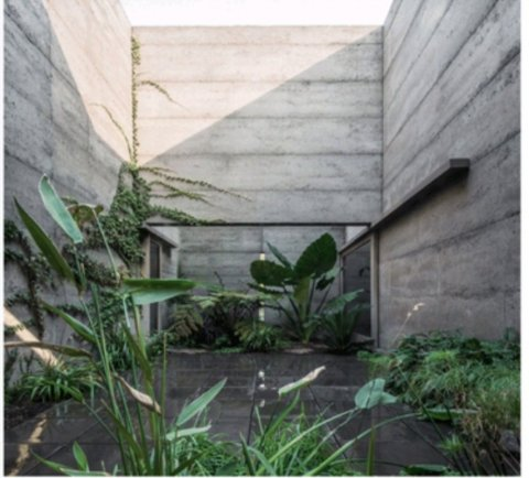 Inner courtyard 4.5mH walls. House by Morq Architecture