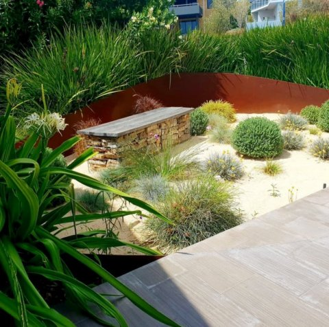 Contemporary perennial garden in gravel East Freo